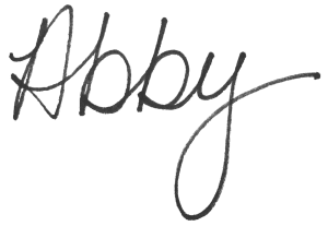 "Black, large script of Abby McCarrel's signature simply written as ""Abby,"" for Family Trauma Therapy."
