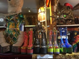 Colorful shelf of platform shoes decorate the shelf in the vintage boutique on a Connected Family Fun, LA: Topanga Canyon family therapy outing.