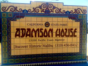 Sign for the Adamson House made of yellow and blue tiles describing information for families to visit on the Connected Family Fun, LA; Malibu Lagoon family counseling assignment.