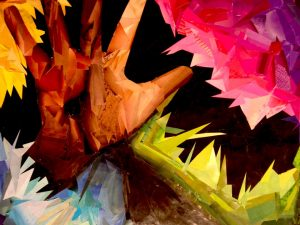 "Art mosaic of a human hand reaching out palm up towards a ""high five"" breaks through colorful, spiked images with black background as an expression of a gifted child's mind."