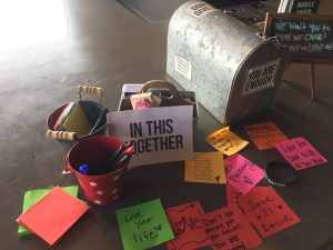Coffee shop with signs about how we are all in this together-Covid-19